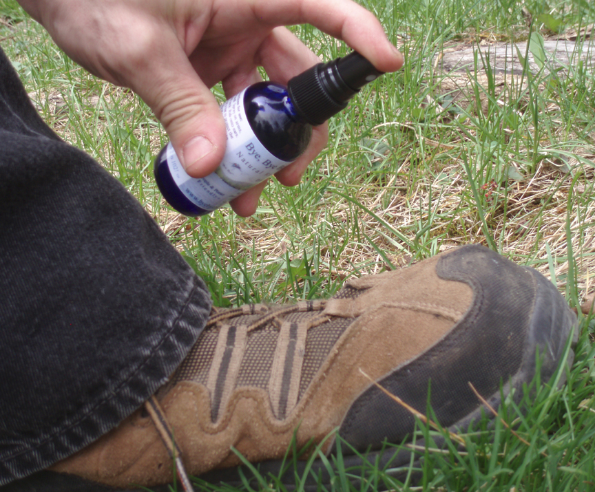Spraying your shoes and pant legs with an effective natural repellent to keep ticks from latching on.